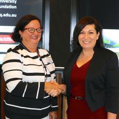 Minister Leeanne Enoch congratulates Professor Boyd